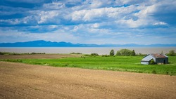 Countryside landscape near the St Lawrence river between Saint Jean Port Joli and Ste Anne de la Pocatiere in Quebec (Canada)