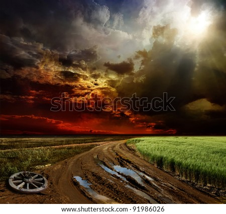 Countryside landscape with dirt road after rain, Russia