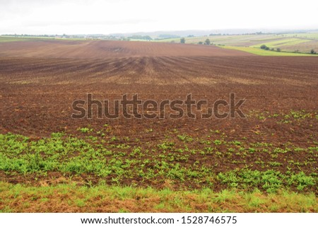 Countryside panorama with arable land in the foreground. With text area. #1528746575