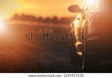 Countryside Road Trip During Scenic Sunset. Car Driving Theme. Automotive Industry. #1245917530