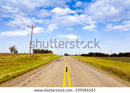 Countryside Road With Windturbines in the background