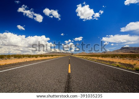 County Highway 91\Littlefield, AZ 86432, USA. Endless road in the desert of Arizona.