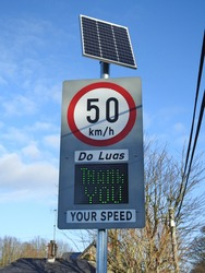 County Louth, Ireland, 6th December 2020. 50 kilometers an hour speed sign and neonspeed indicator on the way into Termonfeckin village. Do Luas is Irish for Your Speed.