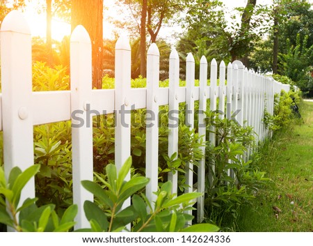 ShutterStock County style wooden fence 142624336