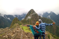 Couple admiring the spectacular view of Machu Picchu, Cusco Region, Urubamba Province, Peru, Archaeological site, UNESCO World Heritage