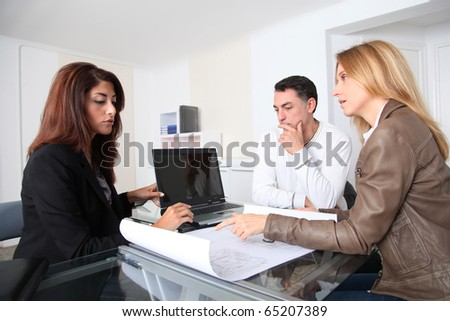 Couple and architect looking at plan - Shutterstock ID 65207389