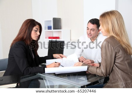 Couple and architect looking at plan