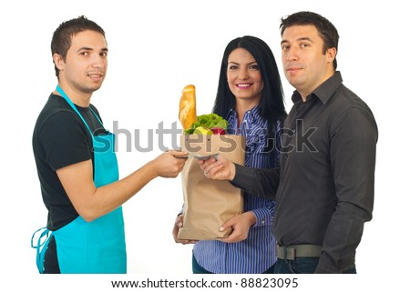 Couple and clerk at grocery isolated on white background
