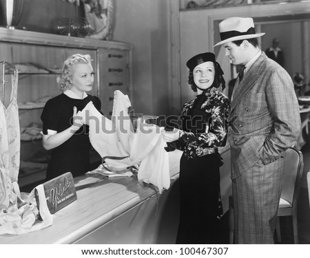 couple and clerk in shop