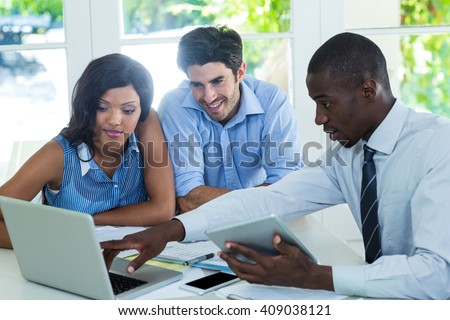 Couple and real estate agent discussing together at home