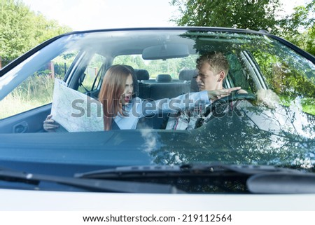 Couple arguing about wrong road in car