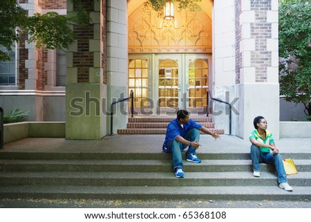 Couple arguing on steps