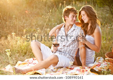 Couple at a picnic in meadow
