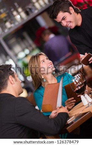 Couple at a restaurant ordering to the waiter