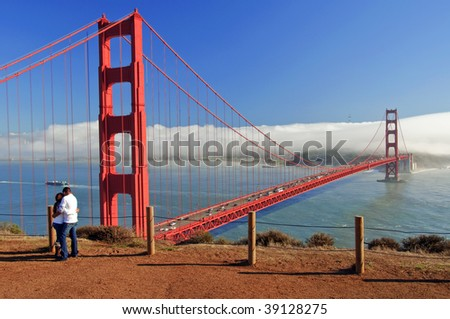 couple at golden gate bridge, san francisco, ca, usa