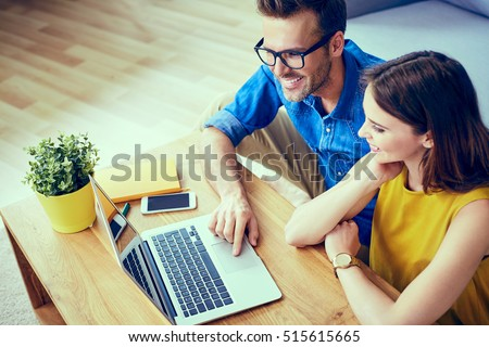 Couple at home doing online shopping with laptop #515615665