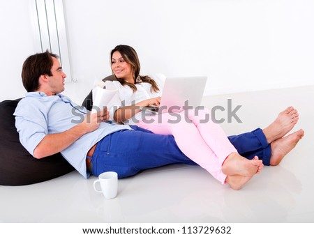 Couple at home spending time together talking