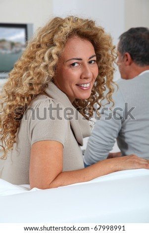 Couple at home watching television - stock photo
