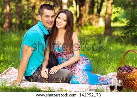couple at outdoor picnic in forest park