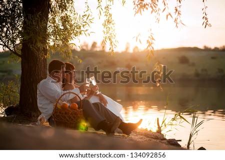 couple at sunset - stock photo
