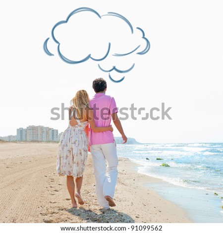 Couple at the beach holding hands and walking. Sunny day, bright colors. Europe, Spain, Costa Blanca. Blank cloud balloon overhead