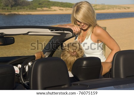 Couple at the beach talking from the car