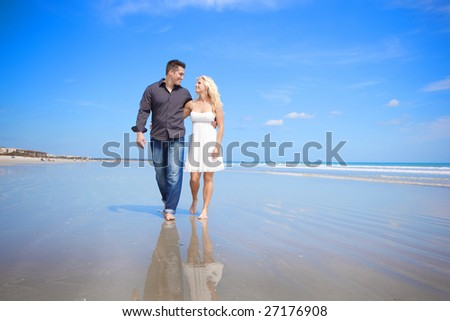 Couple at the beach walking and talking