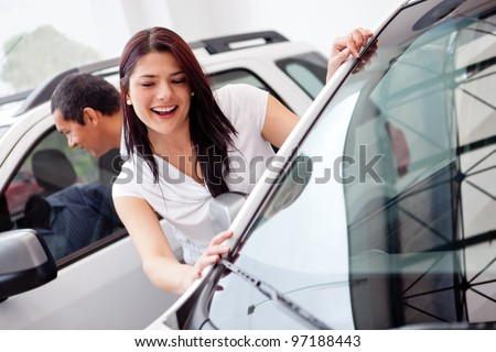 Couple at the dealer looking for a car