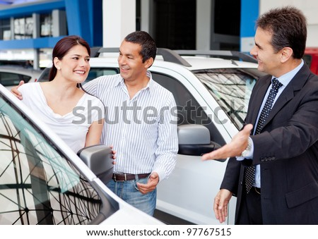 Couple at the dealership buying a new car