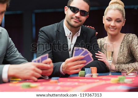 Couple at the poker table in casino