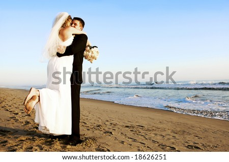 Couple at their beach wedding