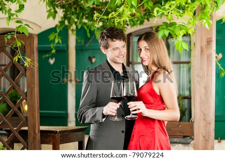 Couple at wine tasting with red wine in a restaurant