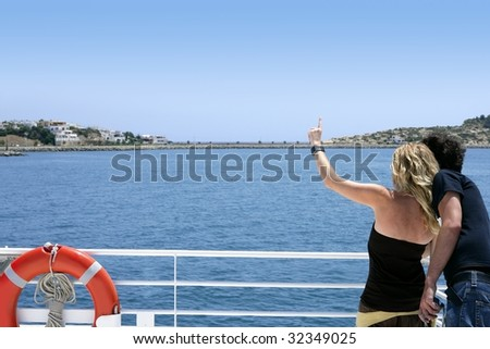 Couple back looking turquoise blue sea in vacation cruise boat