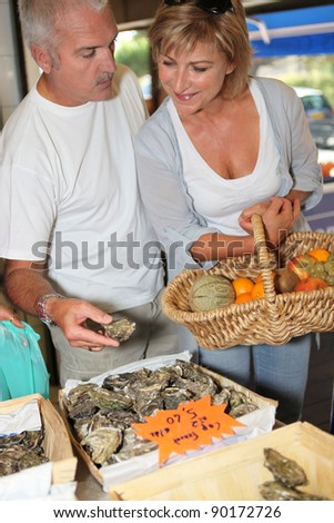 Couple buying oysters