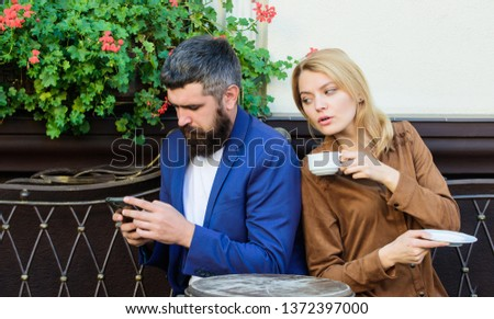 Couple cafe terrace drink coffee. Couple in love sit cafe terrace enjoy coffee. Man secret messaging cheating on wife. Cheat and betrayal. Family weekend. Married lovely couple relaxing together. #1372397000