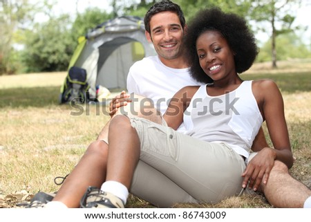 Couple camping in a grassy field