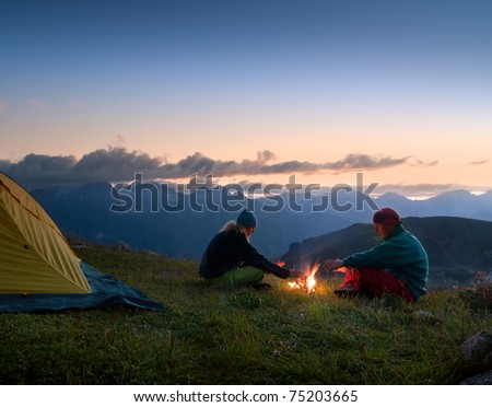 couple camping in the wilderness - stock photo