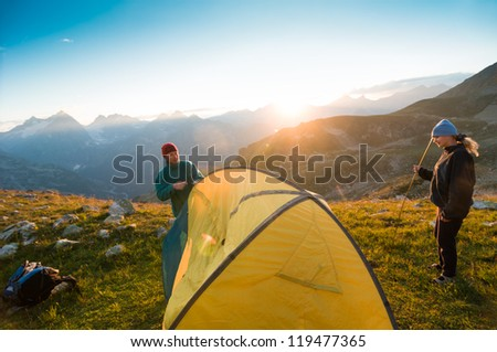 couple camping with tent in mountains