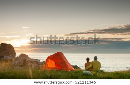 couple camping with tent near seaside