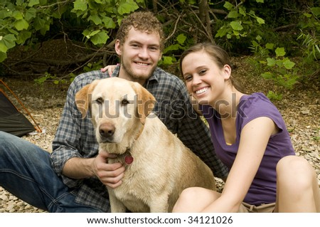 Couple camping with their dog