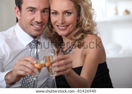 Couple celebrating at home with champagne