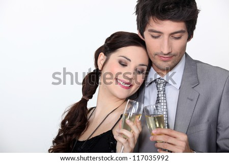 Couple celebrating engagement with champagne
