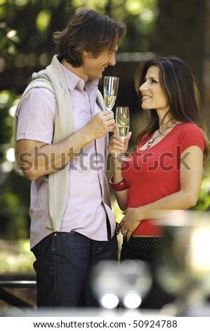 couple celebrating in the garden