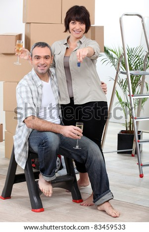 Couple celebrating moving into their new home
