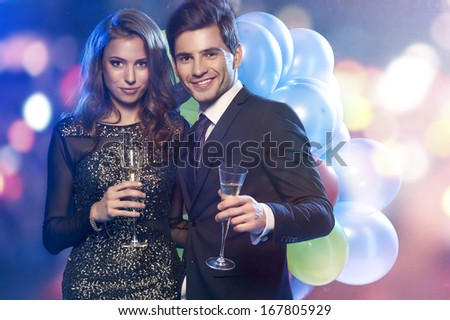 Couple celebrating new year's eve with champagne