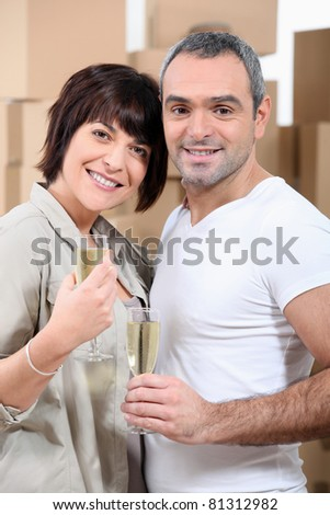 Couple celebrating their move