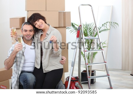 couple celebrating their new apartment