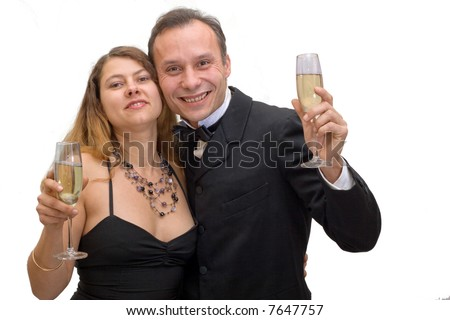 couple celebrating with flutes of champagne