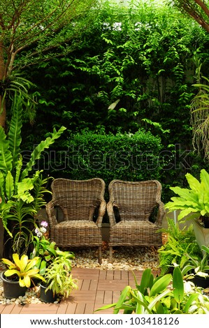 Couple chair in the garden background