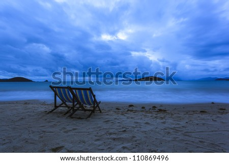Couple chairs in sea beach